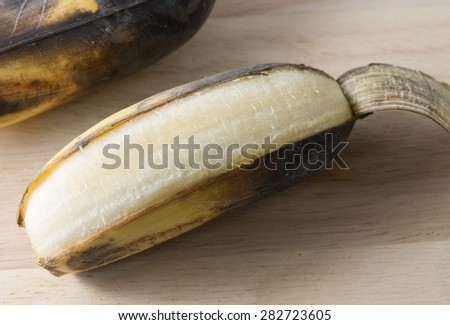Fruits, A Black Rotten Wild Banana, Asian Banana or Cultivated Banana on A Wooden Table. - stock photo
