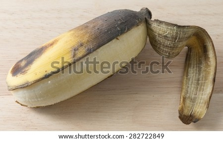 Fruits, An Open Over Ripe Wild Banana, Asian Banana or Cultivated Banana on A Wooden Table. - stock photo