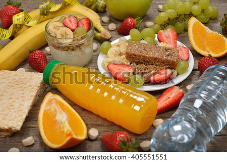 Fruits and cereals on a wooden background, dieting concept - stock photo