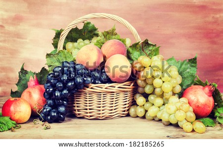 Fruits and grapes. Vintage retro hipster style version  - stock photo