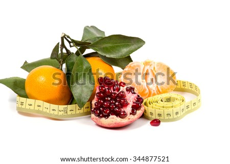 fruits and measuring tape on a white background, isolate - stock photo
