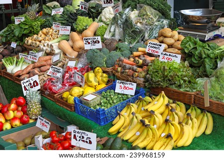 Fruits and vegetables at farmers market stall - stock photo
