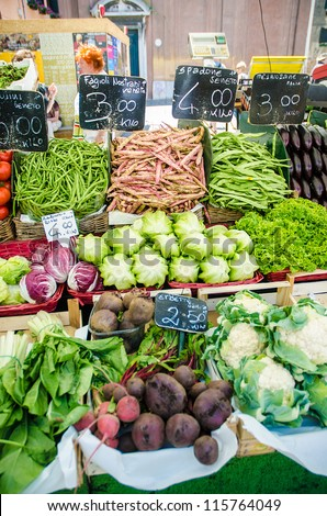 Fruits and vegetables at the market stall - stock photo