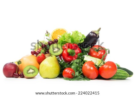 Fruits and vegetables diet weight loss morning breakfast concept  organic green apple egg plant orange tomatoes cucumbers parsley kiwi grapefruit salad peach cherries on table white background - stock photo