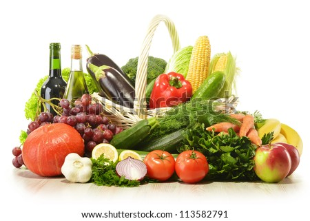 Fruits and vegetables in wicker basket isolated on white - stock photo