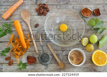 fruits and vegetables ingredients on wooden table with kitchen utensils and brown sugar - stock photo