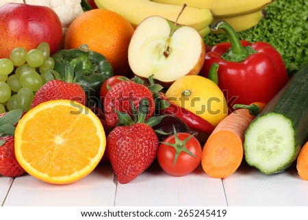 Fruits and vegetables like oranges, apple, tomatoes, banana, strawberry - stock photo