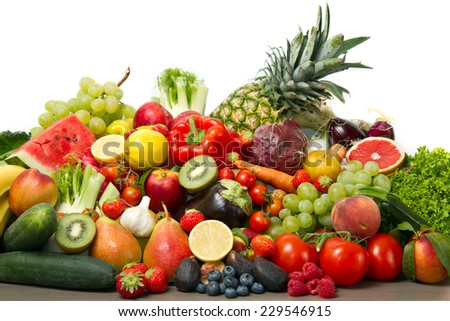 Fruits and vegetables like tomatoes, zucchini, melons, bananas and grapes arranged in a group, natural still life for healthy food  - stock photo