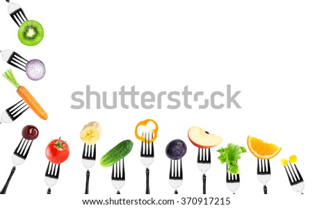 Fruits and vegetables on fork on white background. Food concept