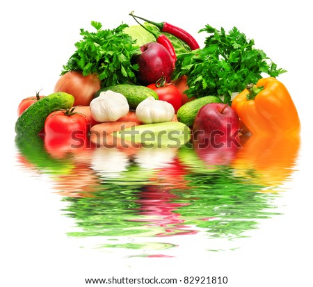 fruits and vegetables reflected in water - stock photo