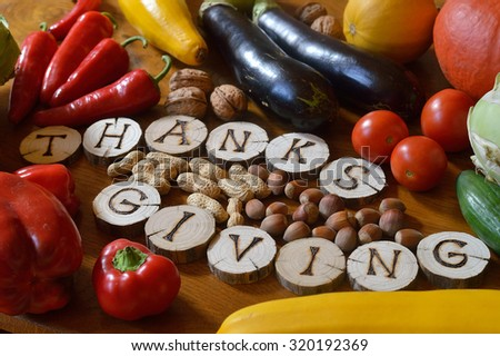 fruits and vegetables with burned wood showing the word thanksgiving - stock photo