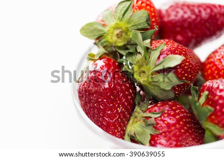fruits, berries, diet, eco food and objects concept - close up of fresh ripe red strawberries over white - stock photo