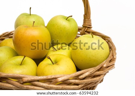 Fruits - Closeup of basket with fresh Golden apples isolated on white background. - stock photo