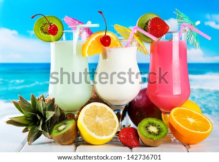 fruits cocktails on a beach - stock photo