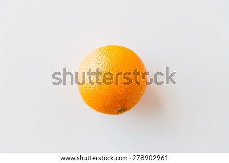 fruits, diet and objects concept - ripe orange over white - stock photo