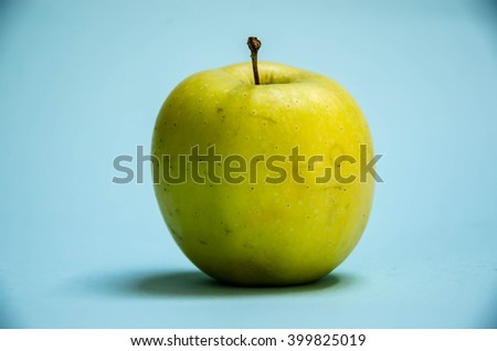 fruits, diet, eco food and objects concept - ripe green apple over white - stock photo
