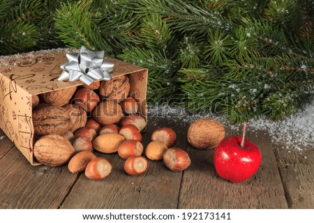 Fruits falling from gift box on wooden plank  - stock photo