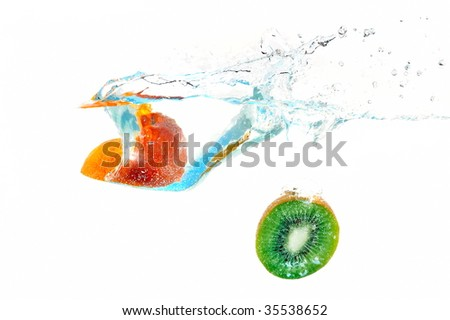fruits falling into water - stock photo