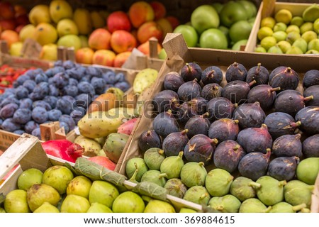 Fruits in boxes for sale in Italian market - stock photo
