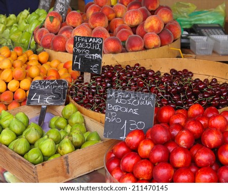 Fruits in crates at farmers market - stock photo