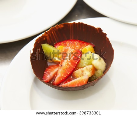 Fruits in shell of chocolate, horizontal image - stock photo