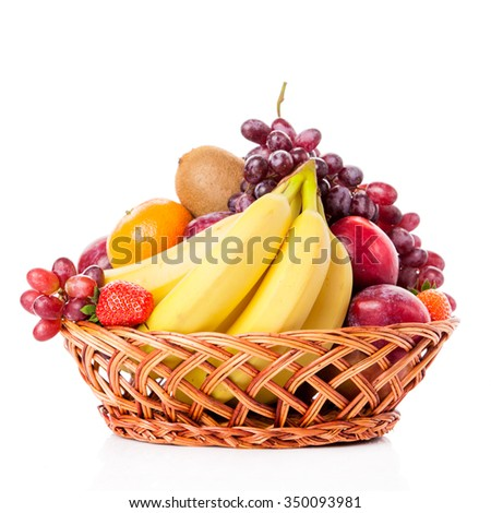 Fruits  in the basket. assorted fruits in wicker basket - stock photo