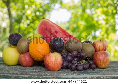 fruits in wooden table, outdoor - stock photo