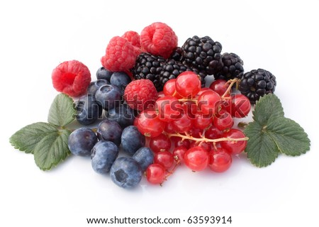 Fruits - Mix of red soft fruits isolated on white background.