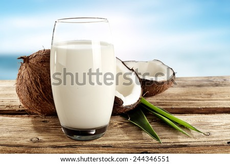 fruits of coconuts and milk in glass  - stock photo
