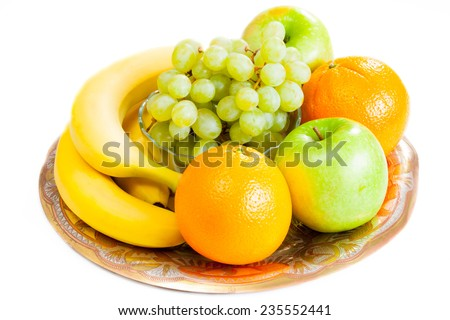 Fruits on a dish - stock photo