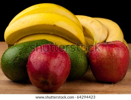 fruits on a wooden table,black background - stock photo