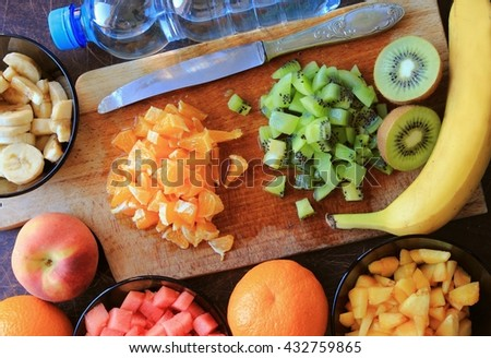 Fruits salad with cutted orange, kiwi, banana and watermelon - stock photo