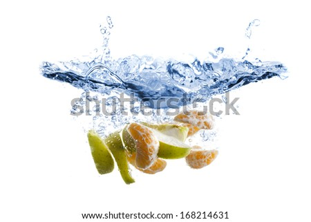 Fruits splash in water - stock photo