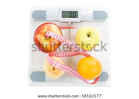Fruits surrounded by a measuring tape on a glass bathroom scale. Blank display.