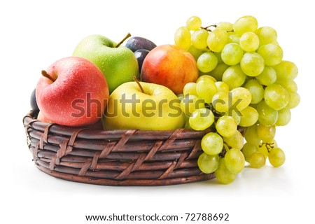 Fruits. Various fresh ripe fruits arranged in a wicker basket isolated on white background - stock photo