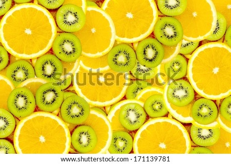 Fruity background set of slices of orange fruit and kiwi. Many slices of kiwi fruit and orange fruit, Fresh kiwis and orange fruit, interesting fruit composition - stock photo