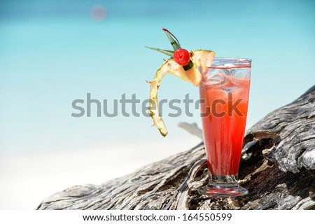 fruity mocktail drink on beach - stock photo