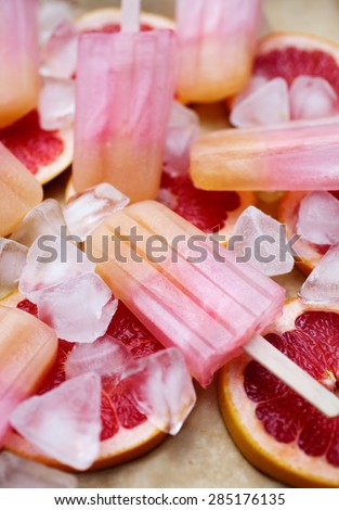 Fruity popsicles with ice and bloodorange - stock photo