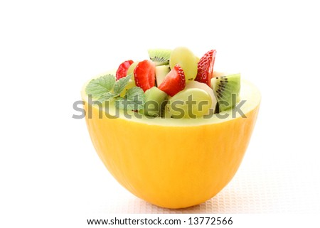 fruity salad in cantaloupe isolated on white