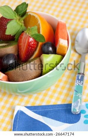 fruity salad with ripe fruits. shallow dof - stock photo
