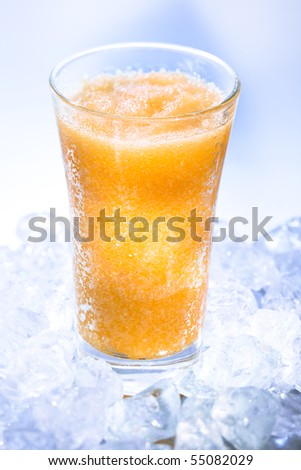 Fruity smoothie on icecubes - stock photo