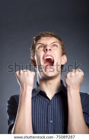 Frustraited angry businessman furious sreaming - stock photo