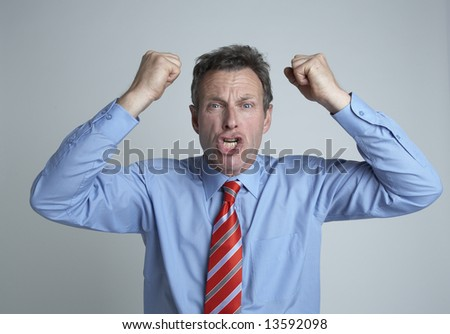 Frustrated and angry Businessman - stock photo