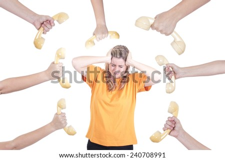 Frustrated and stressed girl and a lot of phones - stock photo