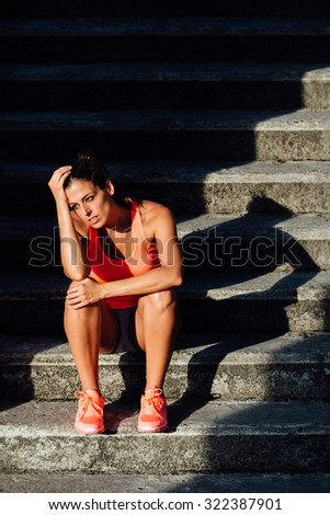 Frustrated and tired sporty woman suffering overtraining. Sport and fitness despair and frustration concept. - stock photo