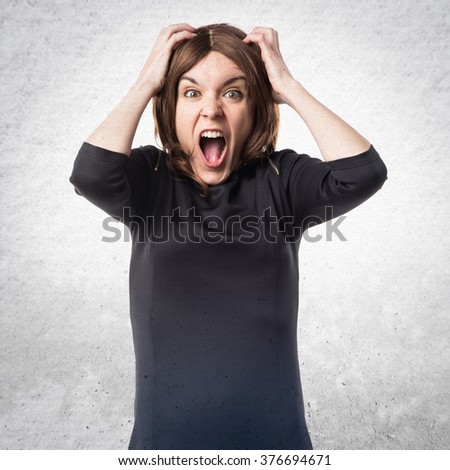 frustrated brunette woman over textured background