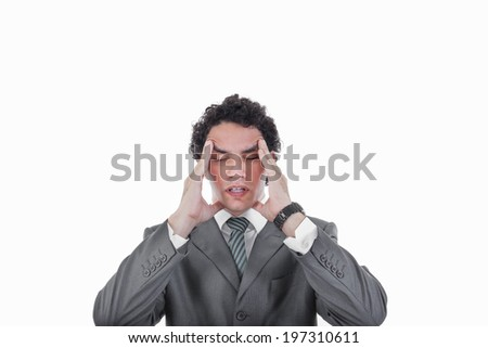 Frustrated business man having severe headache and migraine, Worried businessman suffering from headache - stock photo