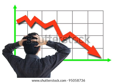 Frustrated business man looking at the falling graph of a stock market struck in financial crisis - stock photo
