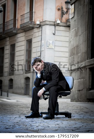 frustrated Business Man sitting on Office Chair on Street in stress - stock photo