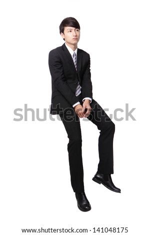 Frustrated business man sitting on something, full length, isolated on white background, asian people - stock photo